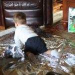 Baby and Toddler Activity:  Fun with an Emergency Mylar Blanket