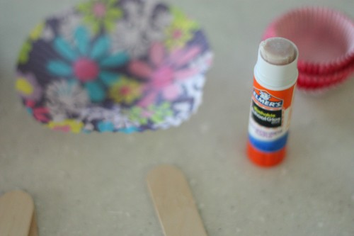 start with gluing the flowers onto the pop sticks