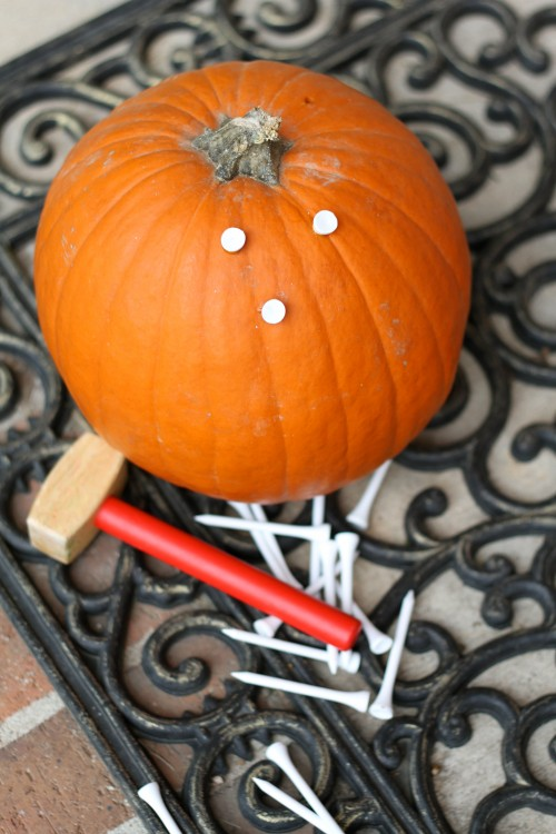 Pounding Golf Tees into a Pumpkin