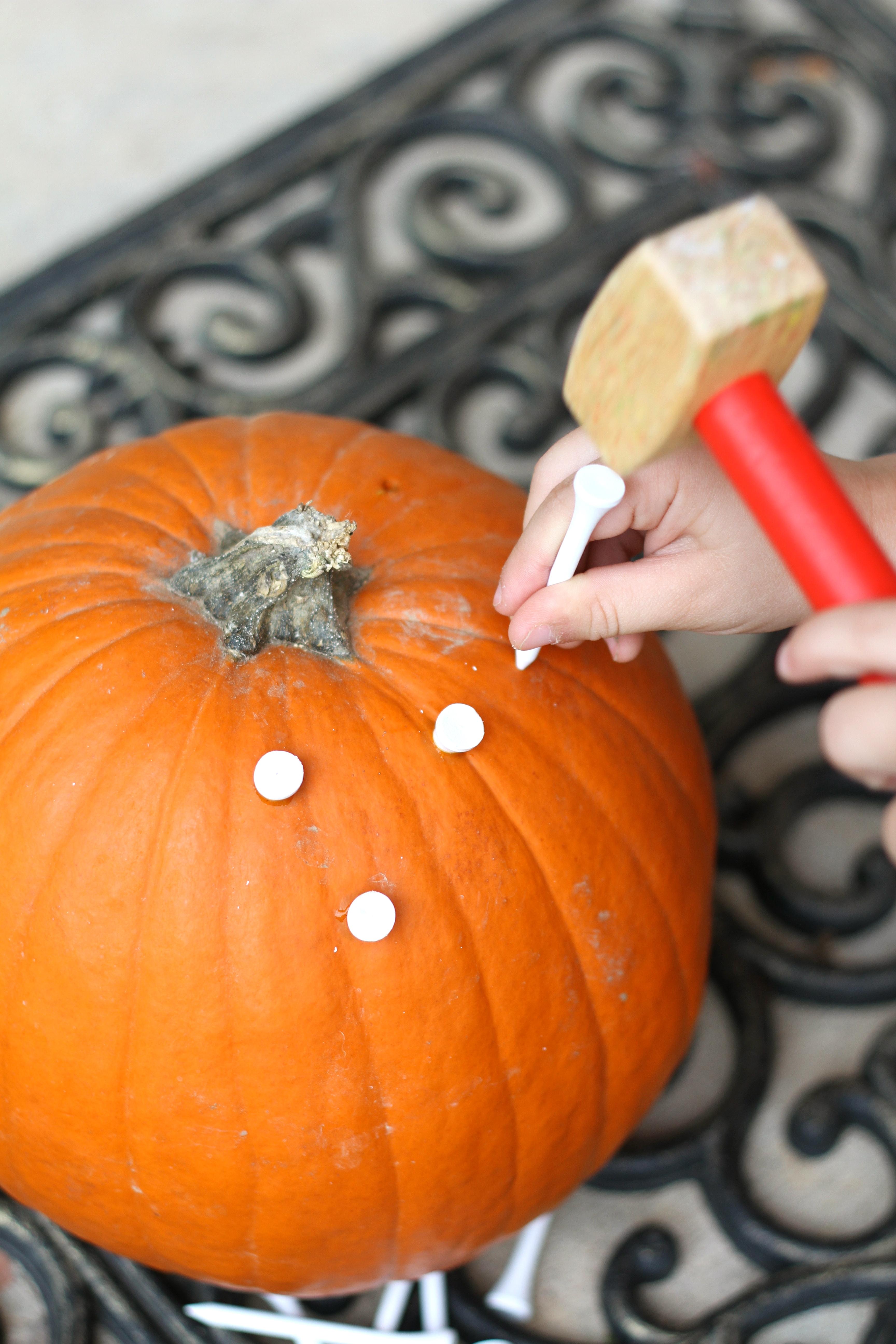 Pounding Golf Tees Into A Pumpkin