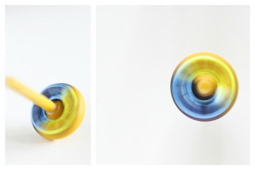 Blue and yellow spinning top