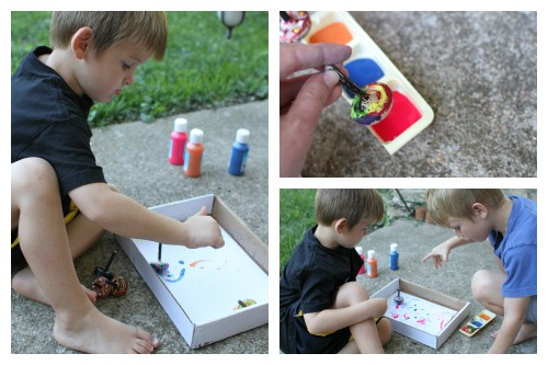 Kids painting with tops