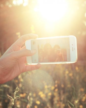 The Case Against Posting Pictures with Friends